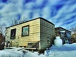 Tin shack in the Woodyard of Yellowknife in winter