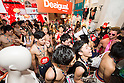 Spanish fashion brand Desigual holds its second seminaked party in Tokyo on Saturday June 21st, 2014. On Saturday June 21st 100 lucky participants dressed only in swimwear, some of whom had lined up since the night before, were allowed to choose 2 free items from the Harajuku Desigual store in downtown Tokyo. (Photo by Desigual/AFLO)