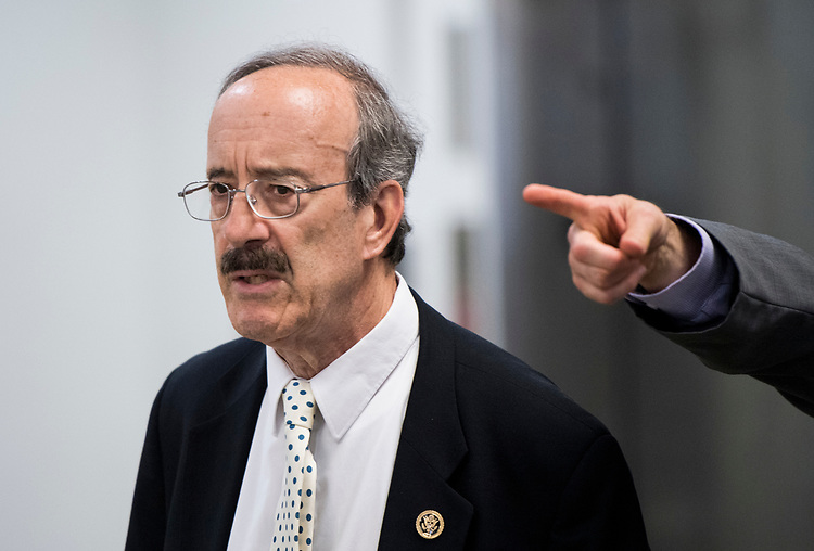 UNITED STATES - JULY 11: A staffer points the way as Rep. Eliot Engel, D-N.Y., makes his way through the Senate subway to one of the Senate office buildings on Wednesday, July 11, 2018. (Photo By Bill Clark/CQ Roll Call/POOL)