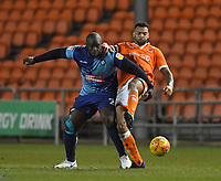 Blackpool's Curtis Tilt battles with Wycombe Wanderers' Adebayo Akinfenwa<br /> <br /> Photographer Dave Howarth/CameraSport<br /> <br /> The EFL Sky Bet League One - Blackpool v Wycombe Wanderers - Tuesday 29th January 2019 - Bloomfield Road - Blackpool<br /> <br /> World Copyright © 2019 CameraSport. All rights reserved. 43 Linden Ave. Countesthorpe. Leicester. England. LE8 5PG - Tel: +44 (0) 116 277 4147 - admin@camerasport.com - www.camerasport.com