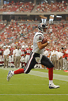 Aug 18, 2007; Glendale, AZ, USA; Houston Texans quarterback Matt Schaub (8) runs for a touchdown against the Arizona Cardinals at University of Phoenix Stadium. Mandatory Credit: Mark J. Rebilas-US PRESSWIRE Copyright © 2007 Mark J. Rebilas