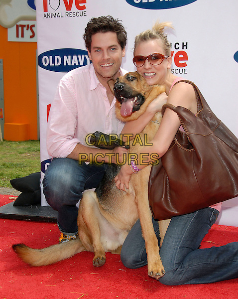 JARON LOWENSTEIN & KALEY CUOCO.attend The Kick off of The Old Navy Nationwide Canine Mascot Search held at Franklin Canyon Park in Beverly Hills, Los Angeles, California, USA,.April 29 2006..full length kneeling dog pet animal hugging .Ref: DVS.www.capitalpictures.com.sales@capitalpictures.com.©Debbie VanStory/Capital Pictures