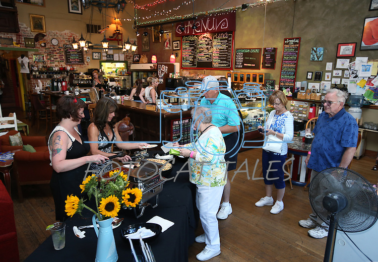Sarah Jones and June Joplin serve samples to Judy, Ken, Jan and Ray Almer at Comma Coffee during the 20th annual Taste of Downtown event in Carson City, Nev., on Saturday, June 15, 2013. The event features 44 local restaurants in a fundraiser for the Advocates to End Domestic Violence.<br /> Photo by Cathleen Allison