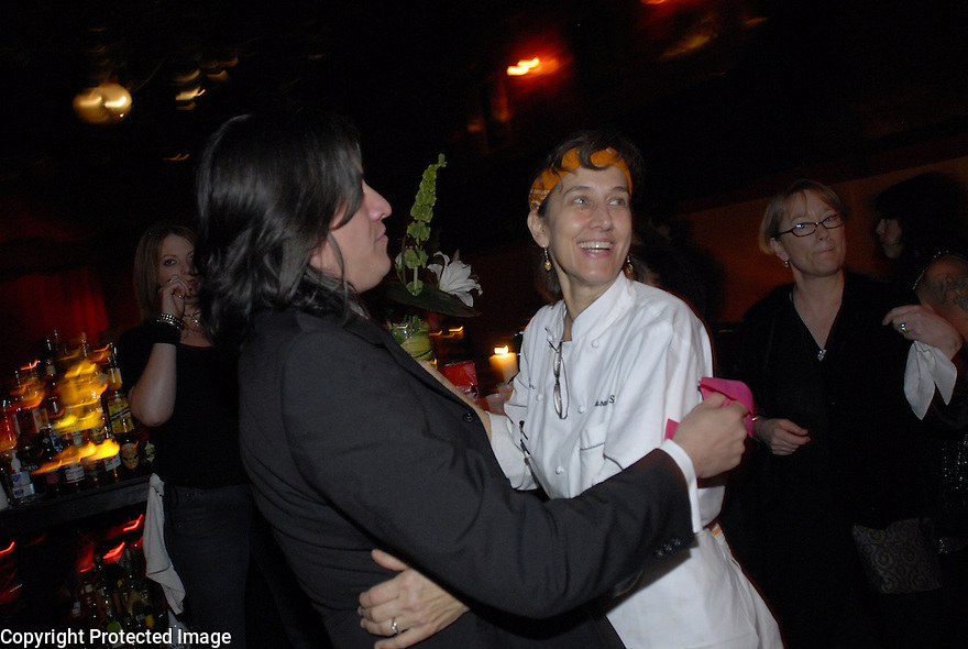 Chris Lee hugs Chef Susan Spicer at the reception at One Eyed Jack's in New Orleans, Saturday, Jan. 12, 2008.
