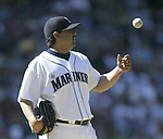 Seattle Mariners pitcher Eddie Guardado tosses the ball into the air after walking Colorado Rockies' Coco Williams in the 11th inning on Sunday, July 2, 2006 in Seattle. Jim Bryant Photo. ©2010. ALL RIGHTS RESERVED..
