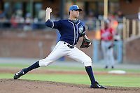 Asheville Tourists starting pitcher Matt Carasiti #10 delivers a pitch during a game against the Rome Braves at McCormick Field on July 25, 2013 in Asheville, North Carolina. The Tourists won the game 9-6. (Tony Farlow/Four Seam Images)