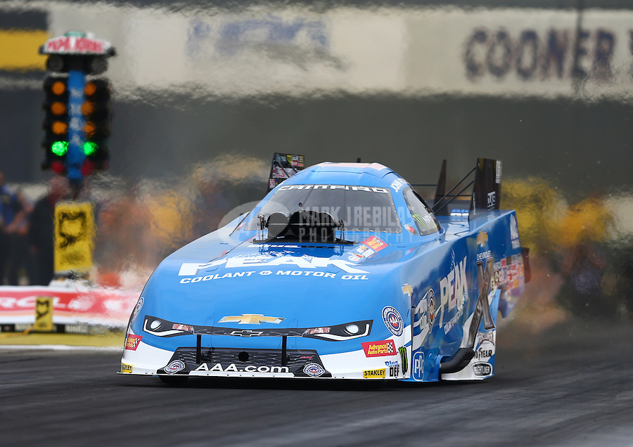 Feb 10, 2017; Pomona, CA, USA; NHRA funny car driver John Force during qualifying for the Winternationals at Auto Club Raceway at Pomona. Mandatory Credit: Mark J. Rebilas-USA TODAY Sports