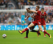 1st October 2017, St James Park, Newcastle upon Tyne, England; EPL Premier League football, Newcastle United versus Liverpool; Ayoze Perez of Newcastle United and Jordan Henderson of Liverpool battle for the ball in midfield in the 1-1 draw