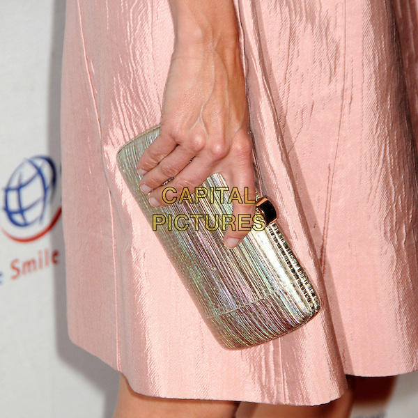 CALISTA FLOCKHART's clutch bag .Operation Smile's 2010 Smile Gala held at The Beverly Hilton Hotel, Beverly Hills, California, USA, .24th September 2010.detail hand gold green pink box .CAP/ADM/BP.©Byron Purvis/AdMedia/Capital Pictures.