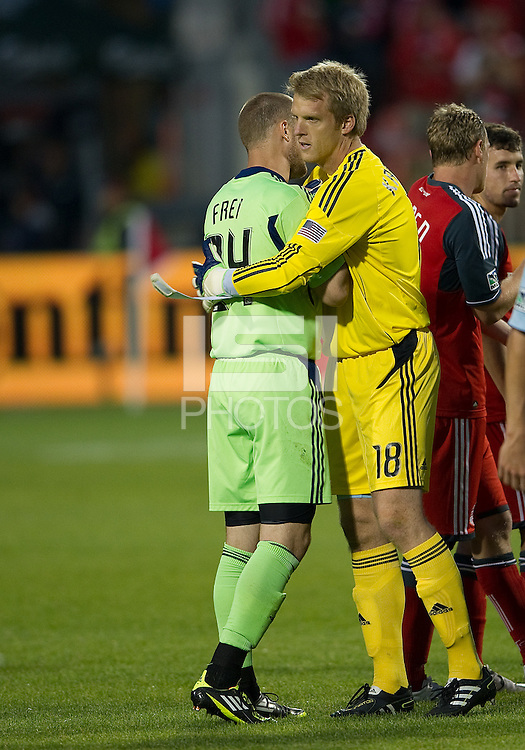 Sporting KC goalkeeper Eric Kronberg #18 and Toronto FC goalkeeper Stefan Frei #24 embrace at the end of a MLS game between Sporting Kansas City and the Toronto FC at BMO Field in Toronto on June 4, 2011..The game ended in a 0-0 draw...