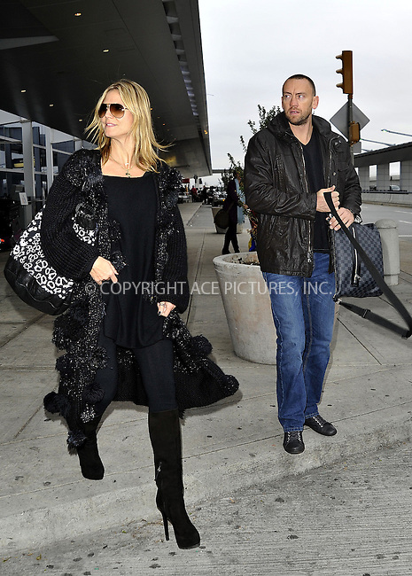 WWW.ACEPIXS.COM......December 1 2012, New York City....Model Heidi Klum and her boyfriend Martin Kristen arrive at JFK Airport on December 1 2012 in New York City ......By Line: Curtis Means/ACE Pictures......ACE Pictures, Inc...tel: 646 769 0430..Email: info@acepixs.com..www.acepixs.com