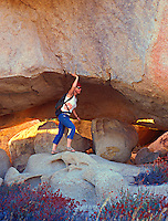 San Diego hiker enjoys hopping along the huge boulders of McCain Valley Conservation Area near Boulevard, San Diego County, California.