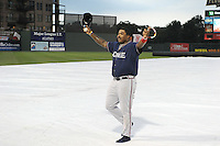 Infielder William Beckwith (48) of the Rome Braves waves to the crowd after catching a ball on the tarp during a lengthy rain delay before a game against the Greenville Drive on July 5, 2012, at Fluor Field at the West End in Greenville, South Carolina. The game eventually was postponed due to rain. (Tom Priddy/Four Seam Images)