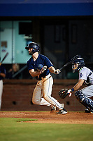 Mobile BayBears third baseman Andrew Daniel (13) follows through on a swing in front of catcher Adrian Nieto (17) during a game against the Pensacola Blue Wahoos on April 25, 2017 at Hank Aaron Stadium in Mobile, Alabama.  Mobile defeated Pensacola 3-0.  (Mike Janes/Four Seam Images)