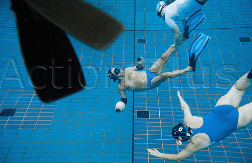 29.07.2015. Berlin, Germany.  Swimmers play underwater rugby in the public swimming pool at the Olympic stadium in Berlin, Germany. The players try to score by placing the ball that is filled with salt water into the basket of the opposing team.