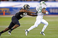 20 December 2011:  FIU tight end Jonathan Faucher (30) chases down Marshall wide receiver Andre Booker (19) during a punt return in the second quarter as the Marshall University Thundering Herd defeated the FIU Golden Panthers, 20-10, to win the Beef 'O'Brady's St. Petersburg Bowl at Tropicana Field in St. Petersburg, Florida.