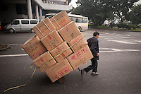 A Man Moving Commercial Goods On A Hand Cart In Chongqing, China.  © LAN