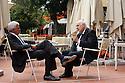 Alessandro Profumo, member of board of Eni, speaks with Giuseppe Garofano, Vice President of Alerion, at Ambrosetti Workshop in Cernobbio, September 2, 2011. © Carlo Cerchioli