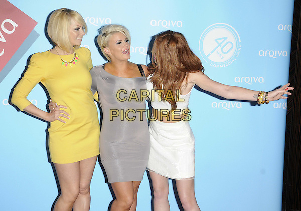 Atomic Kitten - Liz McClarnon, Kerry Katona, Natasha Hamilton<br /> Arqiva Commercial Radio Awards at the Park Plaza, Westminster Bridge, London, England.<br /> July 3th 2013<br /> half length yellow grey gray white dress top cropped skirt midriff hand on hip arm band group profile <br /> CAP/CAN<br /> &copy;Can Nguyen/Capital Pictures