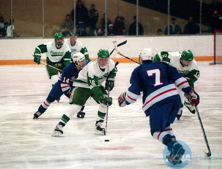 Caption: 14 MAR 1997: Bemidji State's Jerod Bina (16) confronts University of Alabama-Huntsville left defender Marc Lalonde (7) during the Division 2 Men's Hockey Championship at Bemidji State University in Bemidji, MN. Bemidji defeated Alabama 4-2 for the championship title. Monte Draper/NCAA Photos.