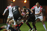 Ulster wing Andrew Trimble runs into trouble as the Dragons defence closes in..Celtic Laegue.Newport Gwent Dragons v Ulster.Rodney Parade.26.10.12.©Steve Pope