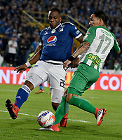 BOGOTA - COLOMBIA - 18 – 02 - 2018: Janeiler Rivas (Izq.) jugador de Millonarios disputa el balón con Dayro Moreno (Der.) jugador de Atletico Nacional, durante partido de la fecha 4 entre Millonarios y por la Liga Aguila I 2018, jugado en el estadio Nemesio Camacho El Campin de la ciudad de Bogota. / Janeiler Rivas (L) player of Millonarios vies for the ball with Dayro Moreno (R) player of Atletico Nacional, during a match of the 4th date between Millonarios and Atletico Nacional, for the Liga Aguila I 2018 played at the Nemesio Camacho El Campin Stadium in Bogota city, Photo: VizzorImage / Luis Ramirez / Staff.