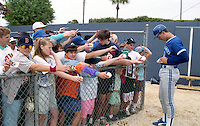 Toronto Blue Jays John Olerud signs autographs during Spring Training circa 1992 at Chain of Lakes Park in Winter Haven, Florida.  (MJA/Four Seam Images)