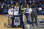 Nevada guard Jazz Johnson (22)  with his family on Senior night after a basketball game against San Diego State played at Lawlor Events Center in Reno, Nev., Saturday, Feb. 29, 2020. (AP Photo/Tom R. Smedes)
