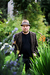 """Writer and poet August Kleinzahler, 60, in the backyard of his home, in San Francisco, Ca., on Friday, February 6, 2008. Kleinzahler recently published his tenth collection of poetry, """"Sleeping it off in Rapid City"""" last year."""
