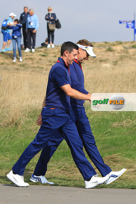 Rory McIlroy and Ian Poulter (Team Europe) on the 3rd during the Friday Foursomes at the Ryder Cup, Le Golf National, Ile-de-France, France. 28/09/2018.<br /> Picture Thos Caffrey / Golffile.ie<br /> <br /> All photo usage must carry mandatory copyright credit (© Golffile | Thos Caffrey)