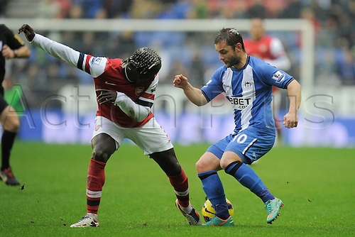 22.12.2012 Wigan, England. Bacary Sagna  of Arsenal and  Shaun Maloney of Wigan in action during the Premier League game between Wigan Athletic and Arsenal at the DW Stadium.