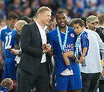 Leicester's Wes Morgan celebrates with Peter Schmeichel during the Barclays Premier League match at the King Power Stadium.  Photo credit should read: David Klein/Sportimage