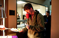 Sigma Alpha Epsilon member John McGoogen (cq) receives his prime rib dinner at the fraternity house on the Southern Methodist University campus in Dallas, Texas, Friday, january 20, 2011. Some high-end chefs have found professional salvation from an unlikely location: Fraternity Row. ..Matt Nager for The Wall Street Journal