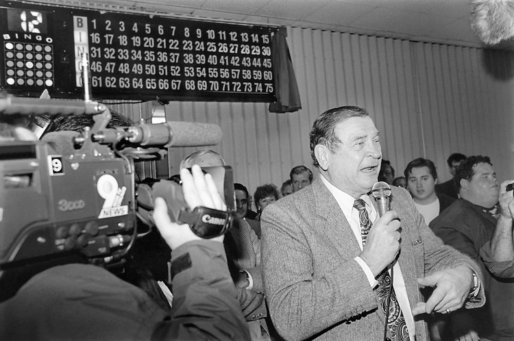 "Rep. Daniel David ""Dan"" Rostenkowski, D-Ill., Chairman of the Ways and Means Committee calling Bingo at his only public campaign appearance. Febuary 19, 1994 (Photo by Chris Martin/CQ Roll Call)"