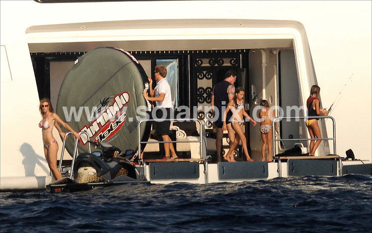 **ALL ROUND PICTURES FROM SOLARPIX.COM**.SYNDICATION RIGHTS FOR UK, CANADA, USA, SOUTH AFRICA, SOUTH AMERICA, DUBAI, AUSTRALIA, NEW ZEALAND, GREECE, ASIA.Rocky star Sylvester Stallone looked relaxed as he sucked on a large Cuban cigar on board his luxury holiday yacht on the coast of Ibiza..The Hollywood hardman sported tattoos on both arms as he strutted around the deck with wife Jennifer Flavin..JOB REF:  6950   SPA   DATE: 03.08.08.**MUST CREDIT SOLARPIX.COM OR DOUBLE FEE WILL BE CHARGED* *UNDER NO CIRCUMSTANCES IS THIS IMAGE TO BE REPRODUCED FOR ANY ONLINE EDITION WITHOUT PRIOR PERMISSION*