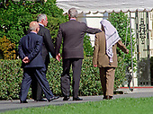 From left to right: King Hussein of the Hashemite Kingdom of Jordan, Prime Minister Benyamin Netanyahu of Israel, United States President Bill Clinton, and Chairman Yassir Arafat of the Palestinian Authority, walk and talk as they leave the Oval Office at The White House in Washington, DC following their discussions on October 1, 1996.<br /> Credit: Ron Sachs / CNP