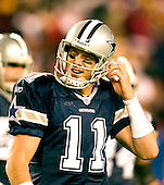 Landover, MD - December 18, 2005 -- Dallas Cowboy Quarterback Drew Bledsoe (11) unsnaps his helmet in disgust during the game at FedEx Field against the Washington Redskins on December 18, 2005.  The Redskins won the game 35 - 7..Credit: Ron Sachs / CNP