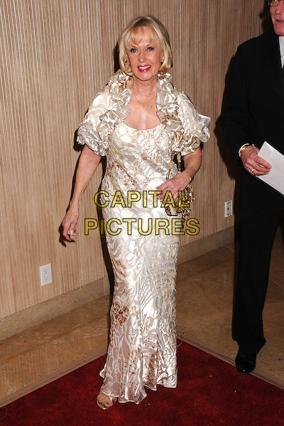 TIPPI HEDRN .40th Annual Academy of Magical Arts Awards at the Beverly Hilton Hotel, Beverly Hills, California, USA, .full length  white cream ruffle neck collar gold cross necklaces gold dress  bag.CAP/ADM/BP.©Byron Purvis/Admedia/Capital PIctures
