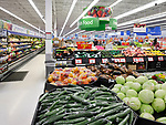 Vegetables at Walmart store fresh food section. Cucumbers, cabbage, sweet peppers. British Columbia, Canada 2017.