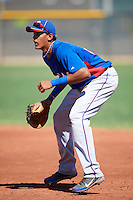Texas Rangers minor league first baseman Ronald Guzman #24 during an instructional league game against the Kansas City Royals at the Surprise Stadium Minor League Complex on October 10, 2012 in Surprise, Arizona.  (Mike Janes/Four Seam Images)