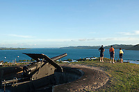 Visitors look out over the Torres Stait islands from the gun battery at Green Hill Fort.  Thursday Island, Torres Strait Islands, Queensland, Australia
