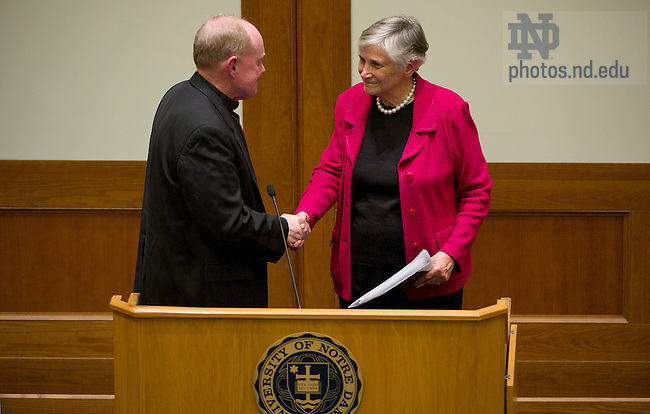 "April 10, 2012; Rev. Timothy R. Scully, C.S.C., Director, Institute for Educational Initatives, shakes hands with Diane Ravitch, Research Professor of Education at New York University, after her address, titled ""Is There a Crisis in Public Education?"" as part of the Forum 2011-12: Reimagining School in Notre Dame Law School's McCartan Courtroom. Photo by Barbara Johnston/University of Notre Dame"
