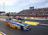 May 17, 2015; Commerce, GA, USA; NHRA funny car driver Matt Hagan (near lane) races alongside Dave Richards during the Southern Nationals at Atlanta Dragway. Mandatory Credit: Mark J. Rebilas-USA TODAY Sports