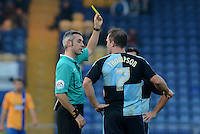Wycombe Wanderers Garry Thompson receives a yellow card from referee Seb Stockbridge during the Sky Bet League 2 match between Mansfield Town and Wycombe Wanderers at the One Call Stadium, Mansfield, England on 31 October 2015. Photo by Garry Griffiths.