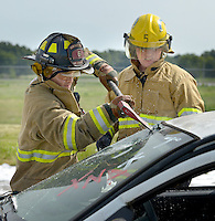 NWA Democrat-Gazette/BEN GOFF &bull; @NWABENGOFF<br /> Cooper Bush (left), Centerton firefighter/paramedic, and cousin Parker Bush, Cave Springs firefighter, conduct vehicle extrication training on Saturday Aug. 8, 2015 during a full-scale training exercise at Northwest Arkansas Regional Airport in Highfill. The exercise for agencies in Benton County that respond to emergencies at the airport simulated a plane crash scenario.