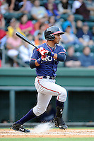 Third baseman Carlos Franco (11) of the Rome Braves bats in a game against the Greenville Drive on Friday, August 1, 2014, at Fluor Field at the West End in Greenville, South Carolina. Rome won, 5-1. (Tom Priddy/Four Seam Images)