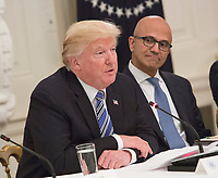 United States President Donald J. Trump (left) participates in an American Technology Council roundtable with corporate and eduction leaders including Microsoft CEO Satya Narayan (right) at The White House in Washington, DC, June 19, 2017. <br /> Credit: Chris Kleponis / CNP /MediaPunch