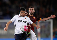 Calcio, Serie A: Roma vs Bologna. Roma, stadio Olimpico, 11 aprile 2016.<br /> Bologna&rsquo;s Sergio Floccari, left, and Roma&rsquo;s Miralem Pjanic fight for the ball during the Italian Serie A football match between Roma and Bologna at Rome's Olympic stadium, 11 April 2016.<br /> UPDATE IMAGES PRESS/Isabella Bonotto