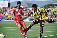 Roy Krishna ( Phoenix ) and Dylan McGowan ( Adelaide ) in action during the A League - Wellington Phoenix v Adelaide United at Hutt Recreational Ground, Lower Hutt, New Zealand on Saturday 7 March 2015. <br /> Photo by Masanori Udagawa. <br /> www.photowellington.photoshelter.com.