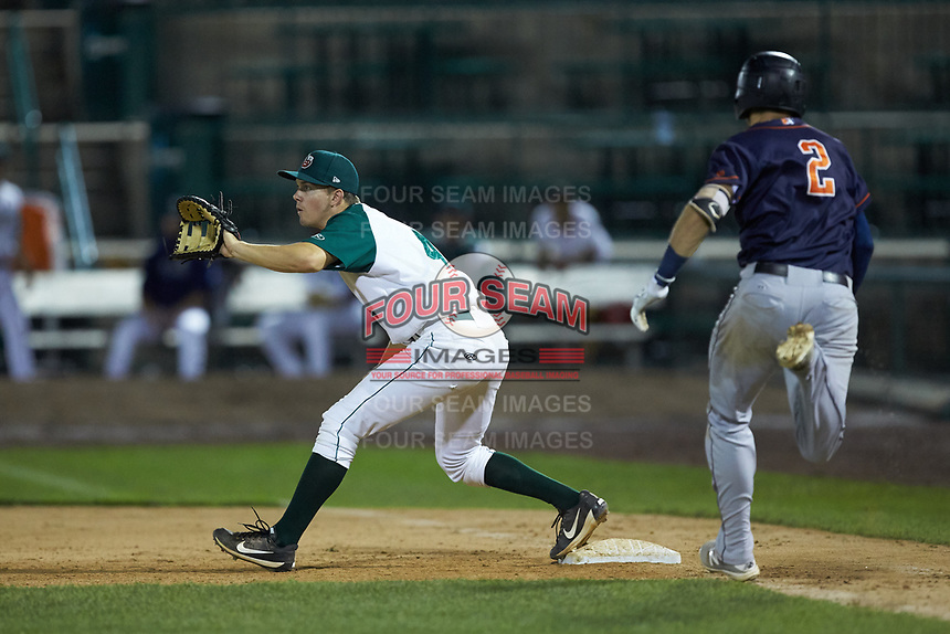 Fort Wayne TinCaps first baseman Chris Givin (4) waits for a throw as Seaver Whalen (2) of the Bowling Green Hot Rods hustles down the line at Parkview Field on August 20, 2019 in Fort Wayne, Indiana. The Hot Rods defeated the TinCaps 6-5. (Brian Westerholt/Four Seam Images)